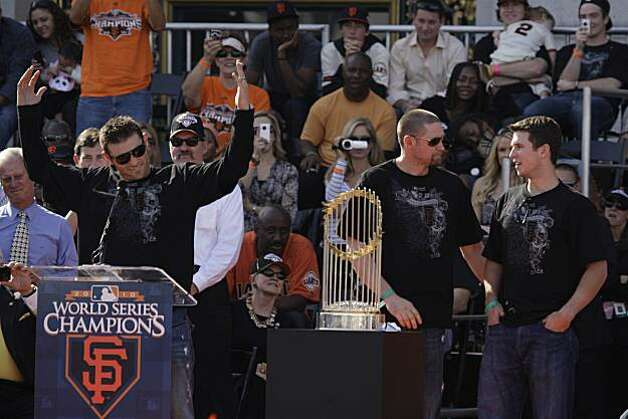 San Francisco Giants' Freddy Sanchez (l to r) acknowledges the crowd while Aubrey Huff and Buster Posey talk on stage during the ceremony at Civic Center Plaza after the World Series parade celebrating the San Francisco Giants win in the 2010 World Series on Monday, November 3, 2010 in San Francisco, Calif. Photo: Lea Suzuki, San Francisco Chronicle