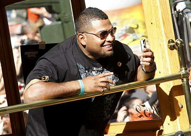 Pablo Sandoval took pictures of the spectacle as he was driven down Market Street Wednesday November 3, 2010. Thousands of San Francisco Giant fans attended a parade in downtown San Francisco, Calif. celebrating the teams World Series victory. Photo: Brant Ward, The Chronicle