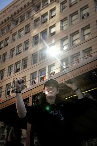 After the San Francisco Giants won the World Series, Tim Lincecum, waves to fans as he makes his way down Market Street  during the victory parade on Wednesday Nov. 03, 2010 in San Francisco, Calif. Photo: Mike Kepka, The Chronicle