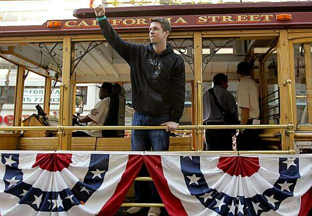 Giants' catcher Buster Posey waves to fans from his cable car, as the City of San Francisco celebrates the World Series Champion Giants with a parade down Market Street, on Wednesday Nov. 3, 2010 in San Francisco, Calif. Photo: Michael Macor, San Francisco Chronicle