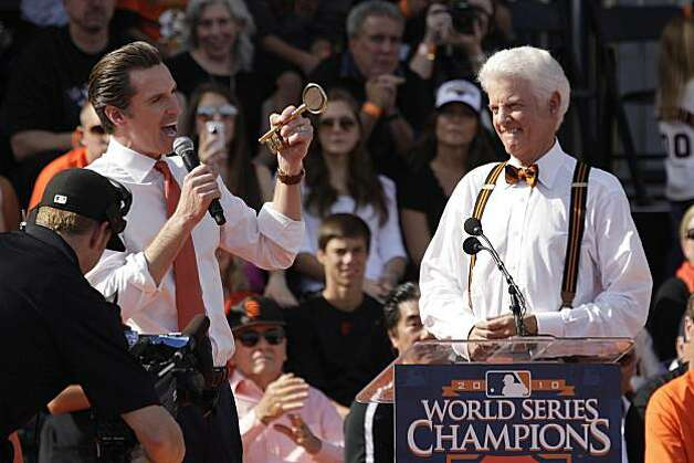Mayor Gavin Newsom (l to r) gives San Francisco Giants managing general partner William Neukom a key to the city during the ceremony at Civic Center Plaza after the World Series parade celebrating the San Francisco Giants win in the 2010 World Series on Monday, November 3, 2010 in San Francisco, Calif. Photo: Lea Suzuki, San Francisco Chronicle