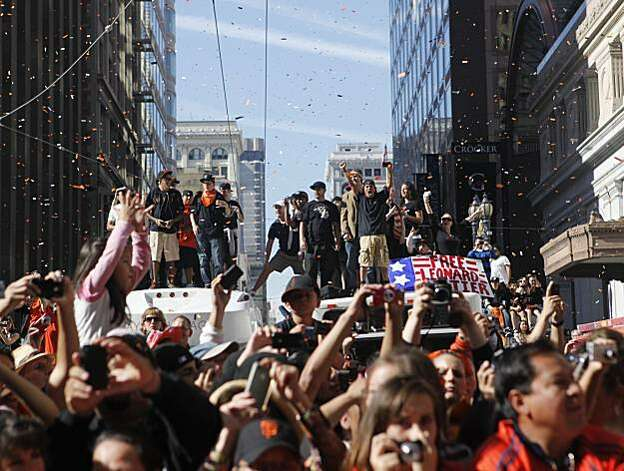 After the San Francisco Giants won the World Series, hundreds of thousands of fans watch the victory parade on Market and Montgomery Streets on Wednesday Nov. 03, 2010 in San Francisco, Calif. Photo: Mike Kepka, The Chronicle