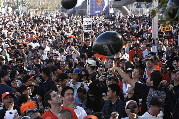 Fans play with ballons while gathering in the morning in Civic Center Plaza before the start of the parade celebrating the San Francisco Giants win in the 2010 World Series on Monday November 3, 2010 in San Francisco, Calif. Photo: Lea Suzuki, San Francisco Chronicle