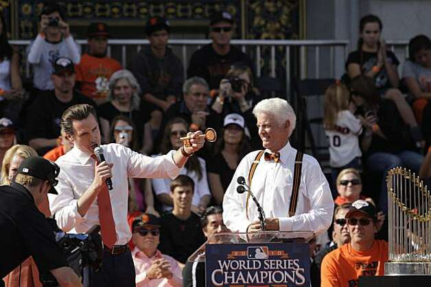 Mayor Gavin Newsom gives San Francisco Giants managing general partner William Neukom a key to the city during the ceremony in front of City Hall after the World Series parade celebrating the San Francisco Giants win in the 2010 World Series on Monday, November 3, 2010 in San Francisco, Calif. Photo: Lea Suzuki, San Francisco Chronicle