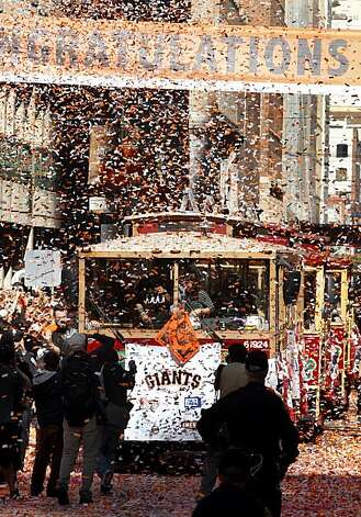 Players in motorized cable cars drove down Montgomery Street. Thousands of San Francisco Giant fans attended a parade in downtown San Francisco, Calif. celebrating the teams World Series victory. Photo: Brant Ward, The Chronicle