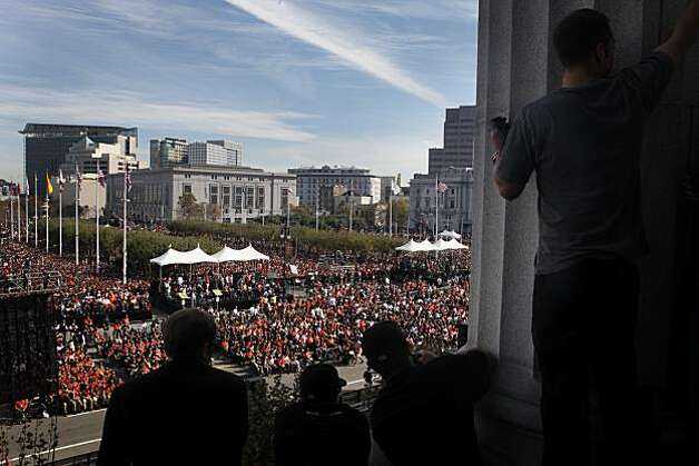 After the San Francisco Giants won the World Series, City Hall employees watch thousands of fans in Civic Center Plaza as players and coaches make an appearance on Wednesday Nov. 03, 2010 in San Francisco, Calif. Photo: Mike Kepka, The Chronicle
