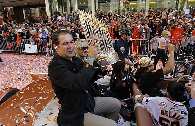 Giants' manager, Bruce Bochy raises the championship trophy for all to see, as the City of San Francisco celebrates the World Series Champion Giants with a parade down Market Street, on Wednesday Nov. 3, 2010 in San Francisco, Calif. Photo: Michael Macor, San Francisco Chronicle