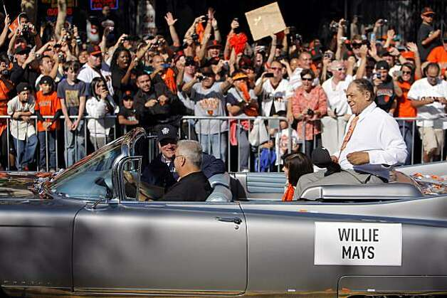 Willie Mays is cheered by the crowd gathered for the parade as he is driven down Market Street. The city of San Francisco held a victory parade for the World Champion San Francisco Giants on Wednesday, November 3, 2010, two days after the team won the World Series against the Texas Rangers. The parade came down Market Street in San Francisco, Calif., and was the same route taken by the parade welcoming the Giants to San Francisco in 1958 when they moved from New York to the west coast. Photo: Carlos Avila Gonzalez, San Francisco Chronicle