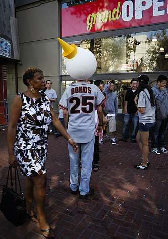A man wearing a Barry Bonds jersey and a clown head walks through the crowd after the parade down Market Street celebrating the San Francisco Giants' World Series win against the Texas Rangers on Wednesday, Nov. 3, 2010 in San Francisco, Calif. Photo: Russell Yip, The Chronicle