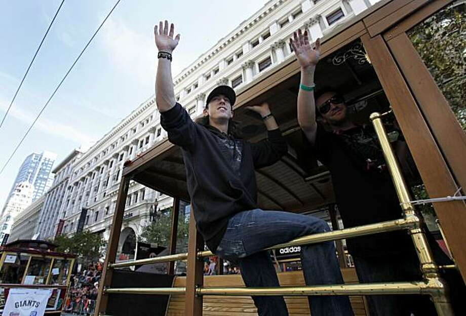 Tim Lincecum waved to the crowd on the north side of Market Street Wednesday November 3, 2010. Thousands of San Francisco Giant fans attended a parade in downtown San Francisco, Calif. celebrating the teams World Series victory. Photo: Brant Ward, The Chronicle