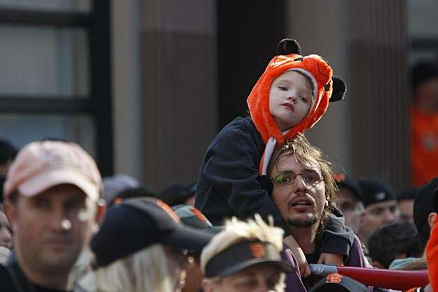 After the San Francisco Giants won the World Series, Lou Triller, 5, and his dad Aaron Triller, of Modesto watch the victory parade on Montgomery Street on Wednesday Nov. 03, 2010 in San Francisco, Calif. Photo: Mike Kepka, The Chronicle
