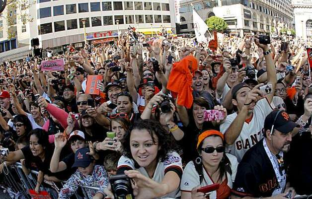 Fans packed in along Market Street to get a glimps of their favorite players, as the City of San Francisco celebrates the World Series Champion Giants with a parade down Market Street, on Wednesday Nov. 3, 2010 in San Francisco, Calif. Photo: Michael Macor, San Francisco Chronicle