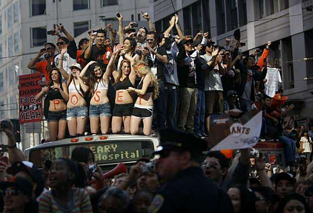 After the San Francisco Giants won the World Series, A mob of fans stand on a MUNI bus to watch the victory parade on Market Street on Wednesday Nov. 03, 2010 in San Francisco, Calif. Photo: Mike Kepka, The Chronicle