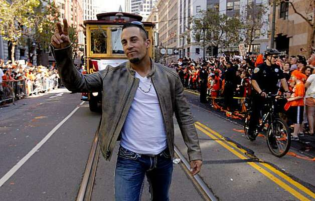 Giants' Andres Torres wave to fans along the route, as the City of San Francisco celebrates the World Series Champion Giants with a parade down Market Street, on Wednesday Nov. 3, 2010 in San Francisco, Calif. Photo: Michael Macor, San Francisco Chronicle