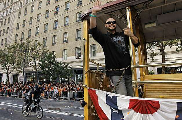 Giants' outfielder Cody Ross waves to fans along Market Street, as the City of San Francisco celebrates the World Series Champion Giants with a parade down Market Street, on Wednesday Nov. 3, 2010 in San Francisco, Calif. Photo: Michael Macor, San Francisco Chronicle