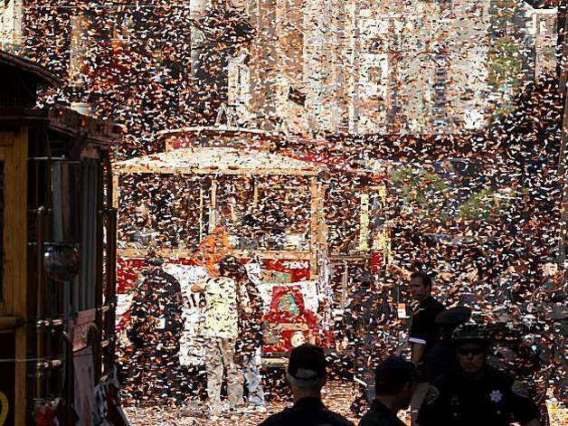 The confetti got thick as the players in motorized cable cars drove down Montgomery Street Wednesday November 3, 2010. Thousands of San Francisco Giant fans attended a parade in downtown San Francisco, Calif. celebrating the teams World Series victory. Photo: Brant Ward, The Chronicle