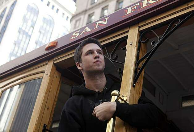 After the San Francisco Giants won the World Series, Buster Posey watches as hundreds of thousands of fans watch his journey during the victory parade on Wednesday Nov. 03, 2010 in San Francisco, Calif. Photo: Mike Kepka, The Chronicle