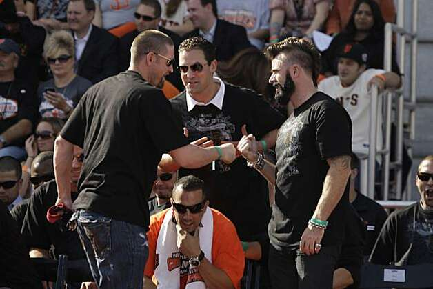 San Francisco Giants' Aubrey Huff (l to r) bump fists after Huff spoke on stage at the ceremony at Civic Center Plaza after the World Series parade celebrating the San Francisco Giants win in the 2010 World Series on Monday, November 3, 2010 in San Francisco, Calif. Photo: Lea Suzuki, San Francisco Chronicle