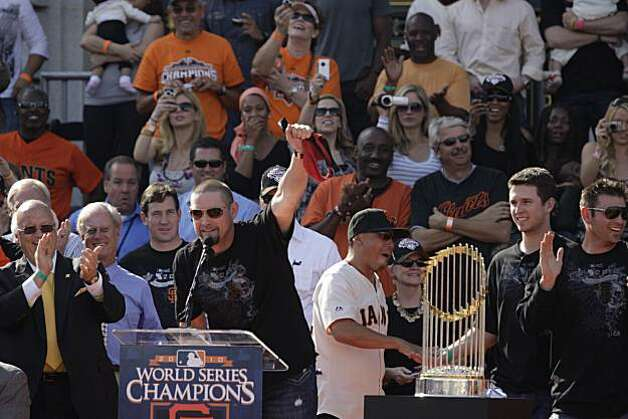 San Francisco Giants' Aubrey Huff (l to r) waves a red thong in the air as Buster Posey and Freddy Sanchez stand on stage with him during the ceremony in front of City Hall after the World Series parade celebrating the San Francisco Giants win in the 2010 World Series on Monday November 3, 2010 in San Francisco, Calif. Photo: Lea Suzuki, San Francisco Chronicle