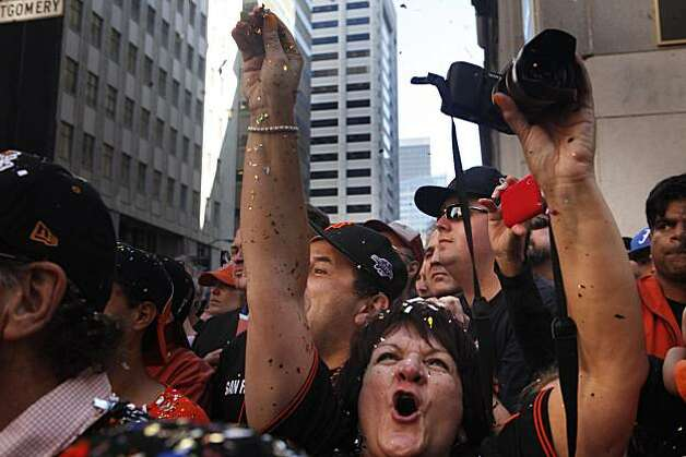 After the San Francisco Giants won the World Series, Teresita Venegas, of Napa, screams as Willie Mays drive past in the victory parade on Market Street on Wednesday Nov. 03, 2010 in San Francisco, Calif. Photo: Mike Kepka, The Chronicle