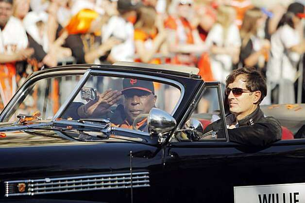 Giants' great, Willie McCovey, waves to the crowd gathered during the parade. The city of San Francisco held a victory parade for the World Champion San Francisco Giants on Wednesday, November 3, 2010, two days after the team won the World Series against the Texas Rangers. The parade came down Market Street in San Francisco, Calif., and was the same route taken by the parade welcoming the Giants to San Francisco in 1958 when they moved from New York to the west coast. Photo: Carlos Avila Gonzalez, San Francisco Chronicle