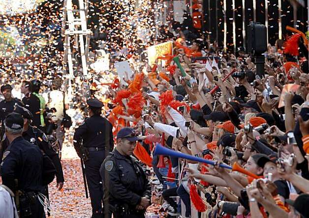 Police kept spectators behind barricades during the parade Wednesday November 3, 2010. Thousands of San Francisco Giant fans attended a parade in downtown San Francisco, Calif. celebrating the teams World Series victory. Photo: Brant Ward, The Chronicle