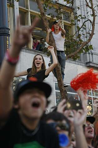 After the San Francisco Giants won the World Series, Fans do their best to see the players coming down Market Street during the victory parade on Wednesday Nov. 03, 2010 in San Francisco, Calif. Photo: Mike Kepka, The Chronicle