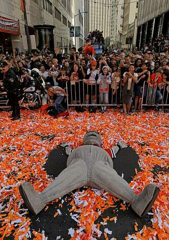 "Giants mascot, ""Lou Seal"" makes an confetti angel along Montgomery Street, as the City of San Francisco celebrates the World Series Champion Giants with a parade, on Wednesday Nov. 3, 2010 in San Francisco, Calif. Photo: Michael Macor, San Francisco Chronicle"