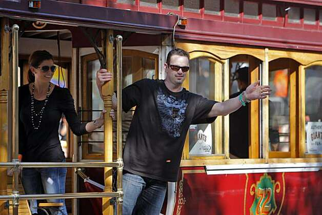 Aaron Rowand waves to the crowd gathered during the parade. The city of San Francisco held a victory parade for the World Champion San Francisco Giants on Wednesday, November 3, 2010, two days after the team won the World Series against the Texas Rangers. The parade came down Market Street in San Francisco, Calif., and was the same route taken by the parade welcoming the Giants to San Francisco in 1958 when they moved from New York to the west coast. Photo: Carlos Avila Gonzalez, San Francisco Chronicle
