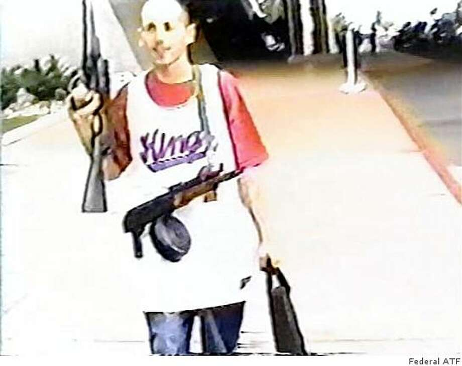 Surveillance camera photo from outside a gun show in Reno in 2005 shows a suspected gang member from Sacramento with a freshly purchased assault rifle. Photo: Xx, Federal ATF