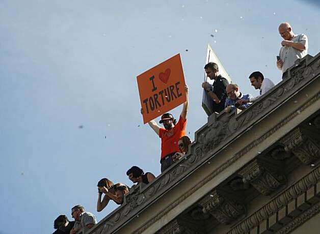 After the San Francisco Giants won the World Series, A man with a message for San Franciscans stands on a Market Steet rooftop during the victory parade on Wednesday Nov. 03, 2010 in San Francisco, Calif. Photo: Mike Kepka, The Chronicle