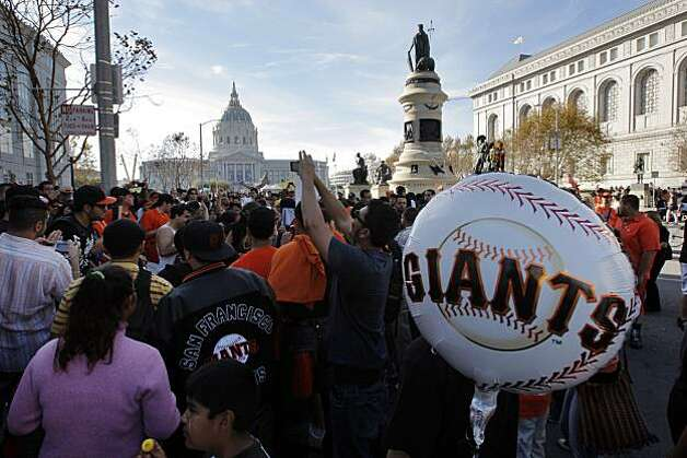 Fans dance in an impromptu drum circle near City Hall where they watched a parade and rally marking the Giants triumphant return from Texas  Wednesday, November 3, 2010, San Francisco, Calif.  The San Francisco Giants celebrate their 2010 World Series win after returning home. Photo: Adm Golub, The Chronicle