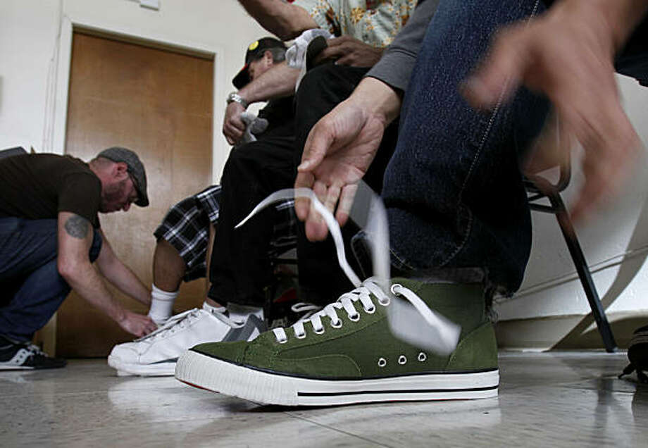 The shoes were described as very comfortable, in green, grey and white. Dozens of Bay Area homeless and low-income veterans received free shoes on Veterans Day at St. Anthony's from local shoe company Chrome Thursday November 11, 2010. Photo: Brant Ward, The Chronicle