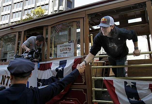 Tim Lincecum shook the hand of a San Francisco policeman on Market Street Wednesday November 3, 2010. Thousands of San Francisco Giant fans attended a parade in downtown San Francisco, Calif. celebrating the teams World Series victory. Photo: Brant Ward, The Chronicle