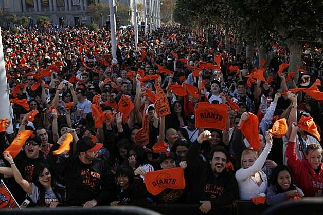 Fans gather in the morning in Civic Center Plaza before the start of the parade celebrating the San Francisco Giants win in the 2010 World Series on Monday November 3, 2010 in San Francisco, Calif. Photo: Lea Suzuki, San Francisco Chronicle