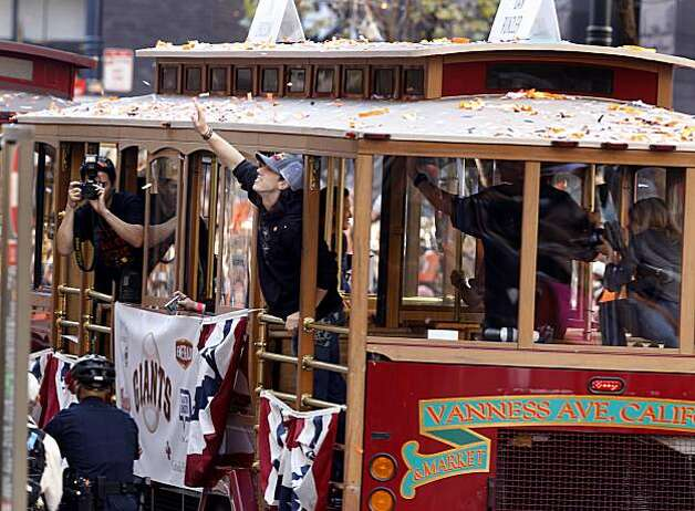 Tim Lincecum waved to the crowd from his confetti covered cable car Wednesday November 3, 2010. Thousands of San Francisco Giant fans attended a parade in downtown San Francisco, Calif. celebrating the teams World Series victory. Photo: Brant Ward, The Chronicle