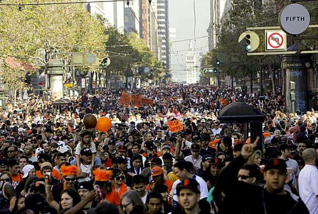 Fans pack Market Street as they follow the parade to Civic Center Plaza for a rally, as the City of San Francisco celebrates the World Series Champion Giants with a parade down Market Street, on Wednesday Nov. 3, 2010 in San Francisco, Calif. Photo: Michael Macor, San Francisco Chronicle