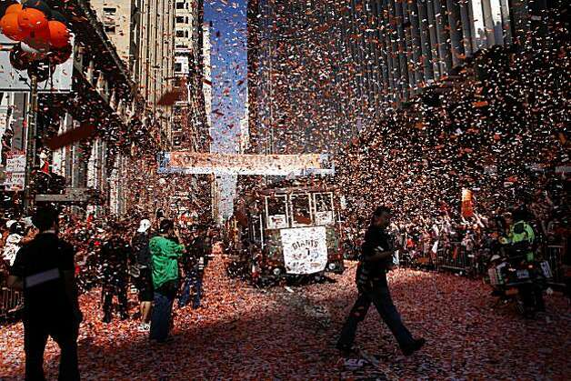 Confetti falls from the sky at Montgomery and Market Streets as the Giants make their way in the victory parade on Wednesday Nov. 03, 2010 in San Francisco, Calif. The San Francisco Giants won the 2010 World Series. Photo: Mike Kepka, The Chronicle