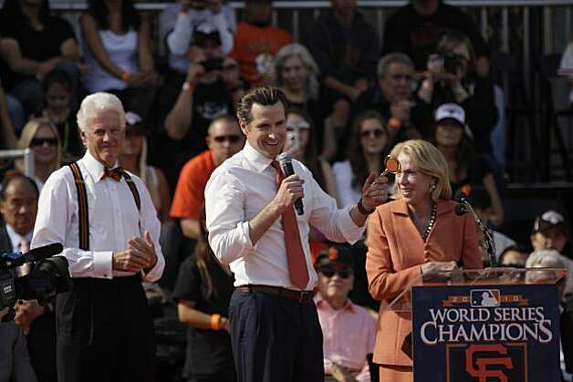 Mayor Gavin Newsom (center) holds a key to the city before giving it to  San Francisco Giants managing general partner William Neukom (left) as Charlotte Shultz (right) looks on during the ceremony in front of City Hall after the World Series parade celebrating the San Francisco Giants win in the 2010 World Series on Monday, November 3, 2010 in San Francisco, Calif. Photo: Lea Suzuki, San Francisco Chronicle