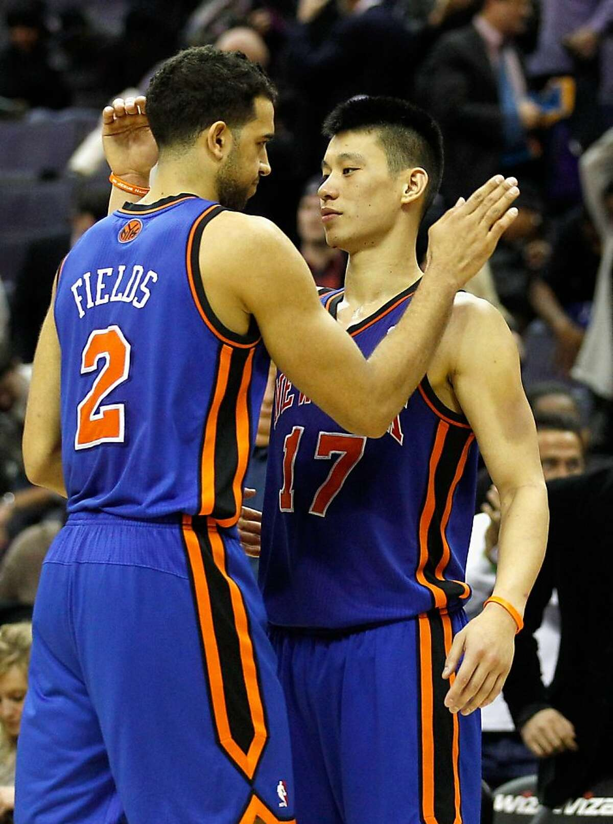 Landry Fields #2 of the New York Knicks and Jeremy Lin #17 celebrate after the Knicks defeated the Washington Wizards at Verizon Center on February 8, 2012 in Washington, DC.