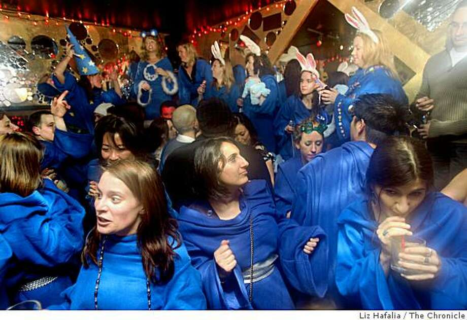 At the Snuggie pub crawl where a bunch of people meeting up in their wearable fleece blankets are now dancing at Vertigo in San Francisco, Calif., on Friday, March 20, 2009. Photo: Liz Hafalia, The Chronicle