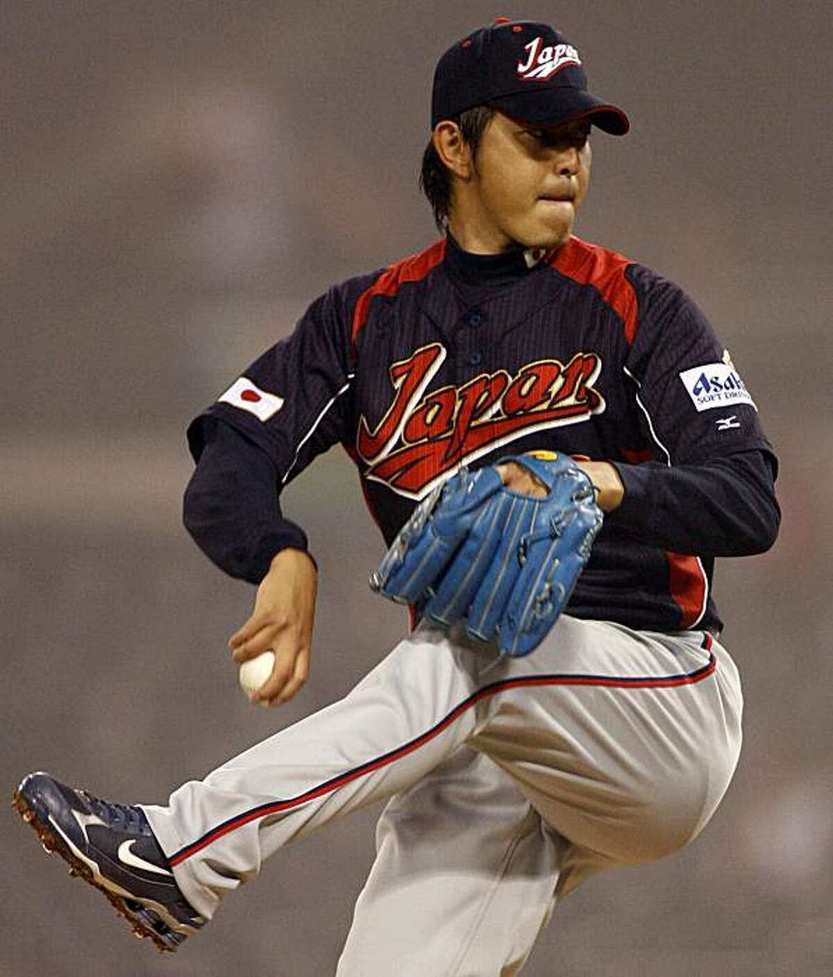 Japan starter Hisashi Iwakuma winds up to deliver a pitch during the sixth inning against Cuba during their World Baseball Classic game in San Diego Wednesday, March 18, 2009. (AP Photo/Denis Poroy)