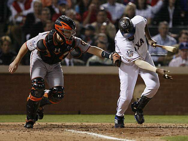 San Francisco Giants catcher Buster Posey tags out Texas Rangers designated hitter Vladimir Guerrero in the seventh inning of Game 5 of the World Series on Monday. Photo: Lance Iversen, San Francisco Chronicle