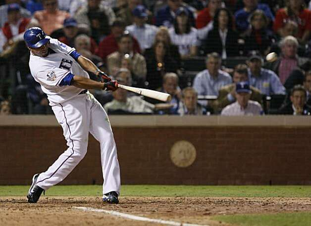 Texas Rangers right fielder Nelson Cruz hits a solo home run in the seventh inning of Game 5 of the World Series against the San Francisco Giants on Monday. Photo: Lance Iversen, San Francisco Chronicle