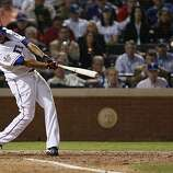 Texas Rangers right fielder Nelson Cruz hits a solo home run in the seventh inning of Game 5 of the World Series against the San Francisco Giants on Monday.