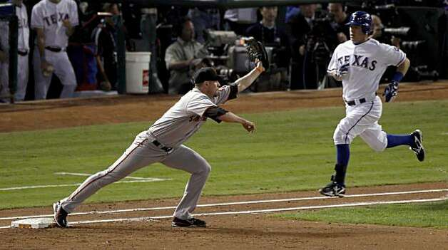 San Francisco Giants first baseman Aubrey Huff (17) makes the play on Texas Rangers' Ian Kinsler (5) in the second inning during game 5 of the 2010 World Series between the San Francisco Giants and the Texas Rangers on Monday, Nov. 1, 2010 in Arlington, Tx. Photo: Carlos Avila Gonzalez, San Francisco Chronicle