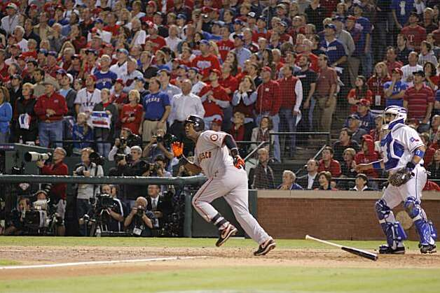 Edgar Renteria watches his seventh inning three-run home run as the San Francisco Giants take Game 5 to win the World Series over the Texas Rangers on Monday. Photo: Michael Macor, San Francisco Chronicle