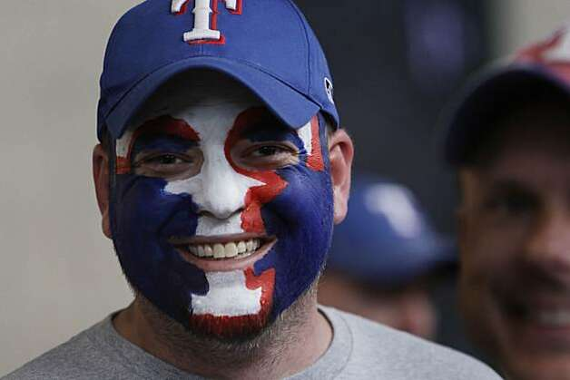 Charlie Barney of Amarillo, Texas, decorates his face to show his support of the Texas Rangers at Game 5 of the World Series at Rangers Ballpark on Monday. Photo: Lea Suzuki, San Francisco Chronicle
