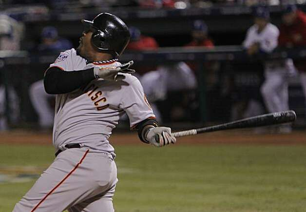 San Francisco Giants shortstop Juan Uribe hits a seventh inning single in Game 5 of the World Series against the Texas Rangers on Monday. Photo: Michael Macor, San Francisco Chronicle
