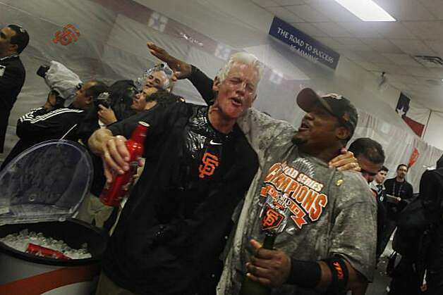 San Francisco Giants managing general partner William Neukom (l to r) and San Francisco Giants Juan Uribe (5) celebrate in the Visiting Clubhouse at Rangers Ballpark after the San Francisco Giants win Game 5 of the World Series over the Texas Rangers 3-1 on Monday November 1, 2010 in Arlington, Texas. Photo: Lea Suzuki, The Chronicle
